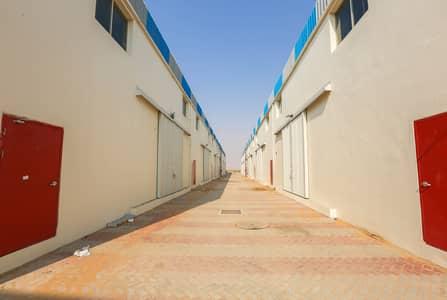 مستودع  للايجار في منطقة الإمارات الصناعية الحديثة، أم القيوين - 180Kw Electric Power Brand New Warehouse for rent in UAQ