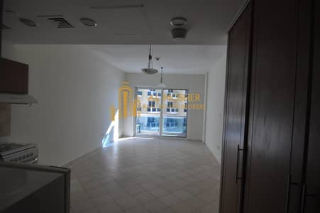 Studio for Rent in Dubai Production City (IMPZ), Dubai - Negotiable price for a Spacious studio for rent with parking (111)