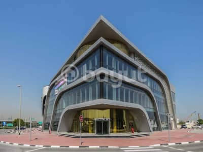 Showroom for Rent in Umm Al Sheif, Dubai - Shell & Core (Showroom ) for rent on SZR facing in brand new building II NO Commission II Direct from the owner
