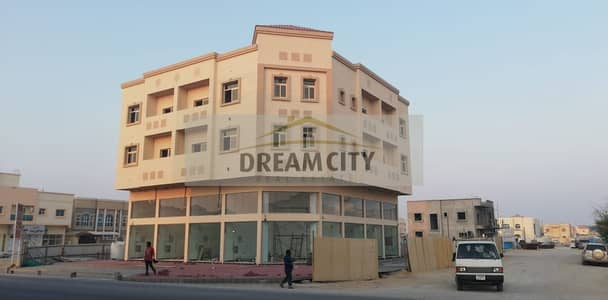 Building for Sale in Al Rawda, Ajman - Building for sale inside the Rawda area, on the corner of two streets, at an amazing price