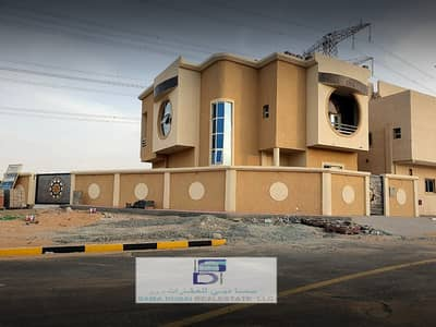 5 Bedroom Villa for Sale in Al Helio, Ajman - Villa for sale on a running street, personal finishing, at an affordable price, for all, freehold all nationalities