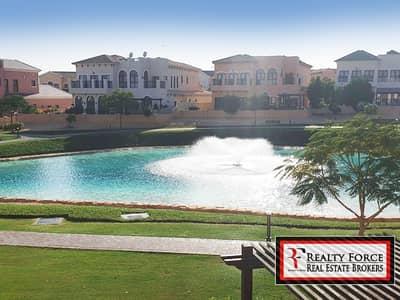 4 Bedroom Villa for Sale in Jumeirah Golf Estate, Dubai - VACANT | FULL LAKE VIEW | TUSCAN TYPE