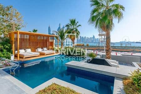 فیلا 4 غرف نوم للبيع في نخلة جميرا، دبي - Upgraded Luxurious Villa | Beachfront Living