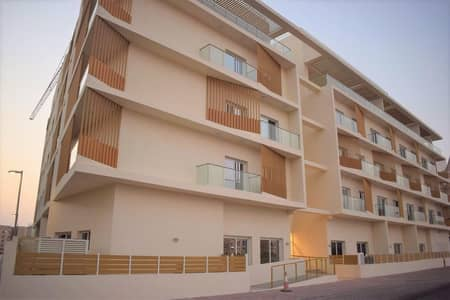 Studio for Rent in Jumeirah Village Circle (JVC), Dubai - Unfurnished 1BR | Near Park | Covered Parking