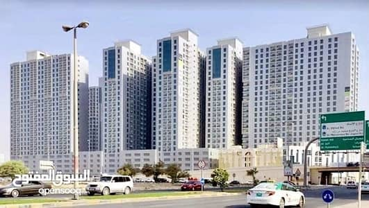 1 Bedroom Apartment for Sale in Al Nuaimiya, Ajman - Apartments ready to live in Ajman with the latest towers in advance of 17 thousand dirhams and installment over 84 months