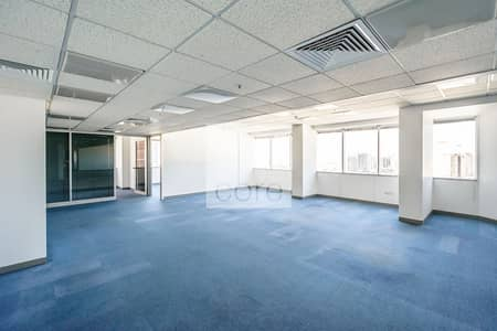 طابق تجاري  للايجار في شارع الشيخ زايد، دبي - Half Floor Office | Fitted and Partitioned