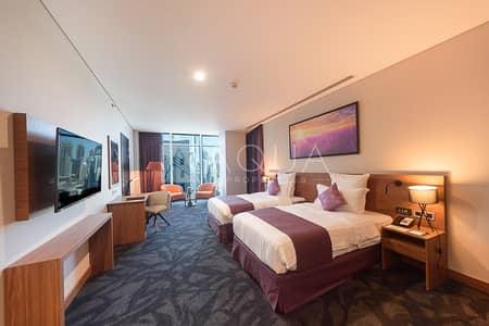 شقة فندقية 1 غرفة نوم للبيع في الخليج التجاري، دبي - No Commission | 5 Year Guranteed 8% net ROI
