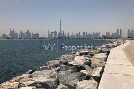 Plot for Sale in Jumeirah, Dubai - Large Beachfront Plot | 5YR P Plan | Sea Views