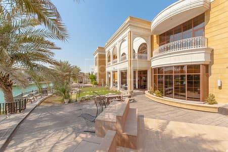 7 Bedroom Villa for Sale in Emirates Hills, Dubai - Lake & Golf Course View | Fully Furnished Custom-Built Villa