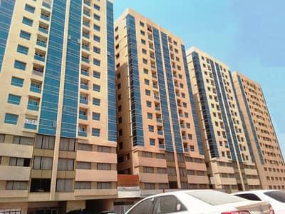 فلیٹ 2 غرفة نوم للبيع في جاردن سيتي، عجمان - شقة في أبراج اللوز جاردن سيتي 2 غرف 210000 درهم - 4502231