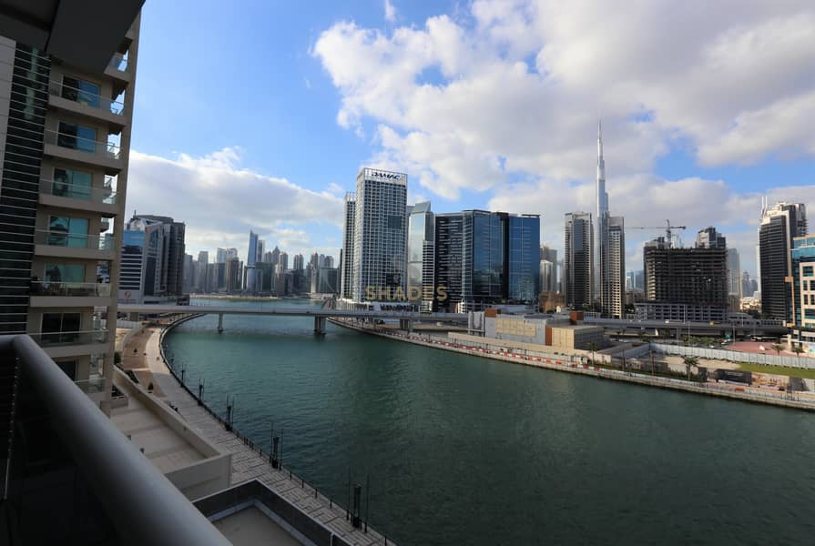 Ideal location | Canal and Burj view | Kitchen appliances