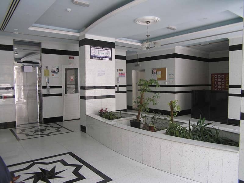 2 1 B/R HALL FLAT WITH SPLIT DUCTED A/C WITH 1 MONTH FREE IN MAHATAH AREA