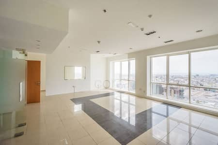 Office for Rent in Sheikh Zayed Road, Dubai - Chiller Inclusive | Fitted and Partitioned