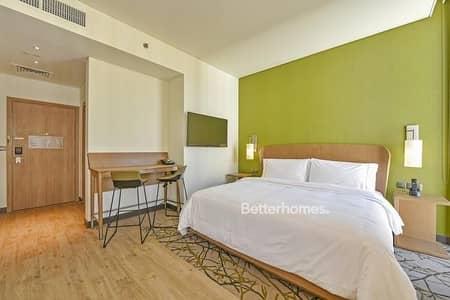 شقة فندقية  للايجار في مدينة دبي للإنتاج، دبي - Fully Furnished Studio Hotel Apartment in IMPZ