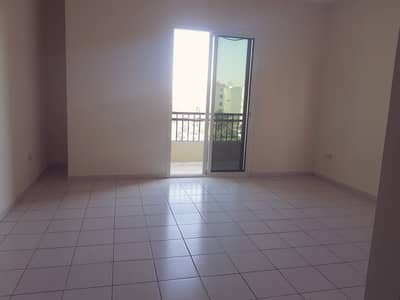 Studio for Rent in International City, Dubai - GREECE CLUSTER: STUDIO WITH BALCONY FOR RENT ONLY IN 19000/-