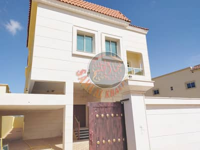 5 Bedroom Villa for Sale in Al Rawda, Ajman - Luxurious villa 6 master rooms with attractive stone facade for sale