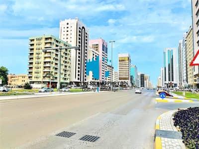 محل تجاري  للايجار في شارع المطار، أبوظبي - HOTTEST location Ever! | Spacious Storefront Shop  - 646 sq ft