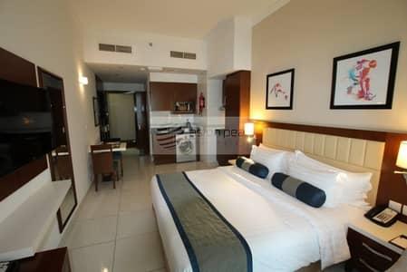 شقة فندقية  للبيع في مدينة دبي الرياضية، دبي - Fully Furnished Studio | Fully Serviced Apartment