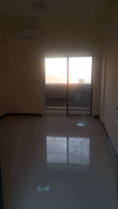 1 Bedroom Apartment for Rent in Al Bustan, Ajman - Apartment room, lounge and balcony for the first inhabitant