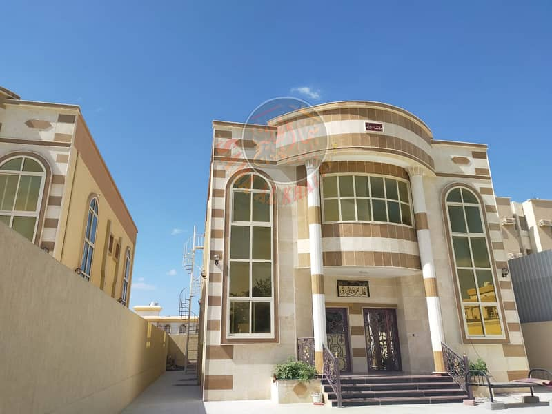 Two storey villa, stone facade for sale in Ajman