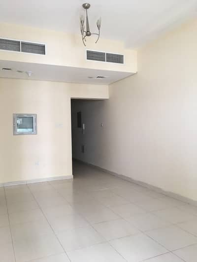 1 Bedroom Flat for Rent in Emirates City, Ajman - Open view 1br RENT in LAVENDER TOWER with parking 2 toilet, big balcony and central AC