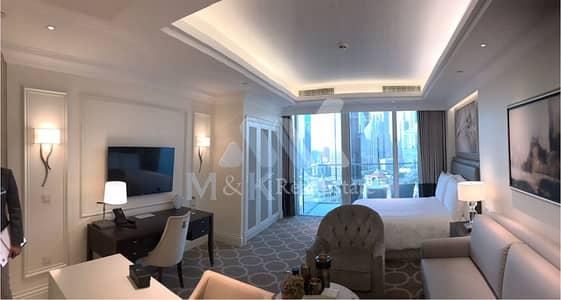 شقة فندقية  للايجار في وسط مدينة دبي، دبي - شقة فندقية في العنوان بوليفارد وسط مدينة دبي 70000 درهم - 4519505