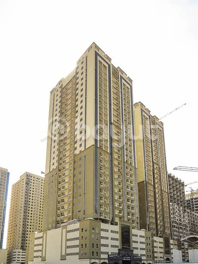 1 Bedroom Flat for Sale in Emirates City, Ajman - For Sale _ One Bedroom + Study Room_ 970 with Parking