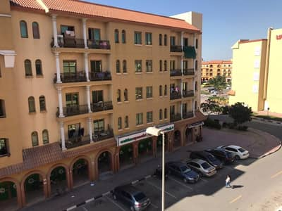 Studio for Sale in International City, Dubai - Well Maintained Rented Studio Apartment in Spain Cluster-S block