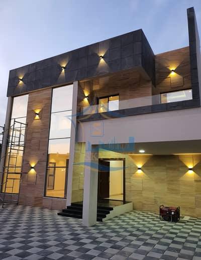 Modern villa for sale Super deluxe finishing, opposite Ajman Academy, Markaz Mall, Carrefour Hill