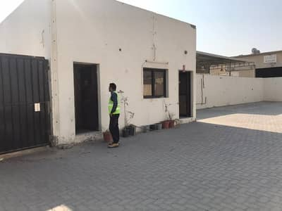 Industrial Land for Rent in Industrial Area, Sharjah - 7,400 Sq/Ft Land with boundary wall and gate office in Industrial no:11 -Sharjah