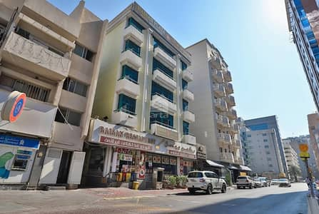 مبنی تجاري  للبيع في ديرة، دبي - Baisan Hotel Apatments | Whole Building + Trade License