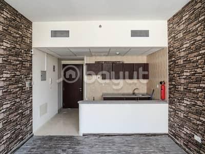 للايجار استديوفسيحة ومشرقة ، مطبخ مفتوح مع خزائن مجهزة في برج لؤلؤة الخليج ، يقع في النهدة الشارقة