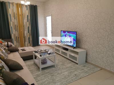 Newly furnished 1BHK  with Balcony 5 minutes to Outlet Mall