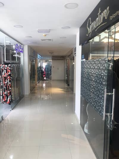 Other Commercial for Sale in Al Mowaihat, Ajman - A commercial residential building for sale on the main street directly with very large income and super deluxe finishes