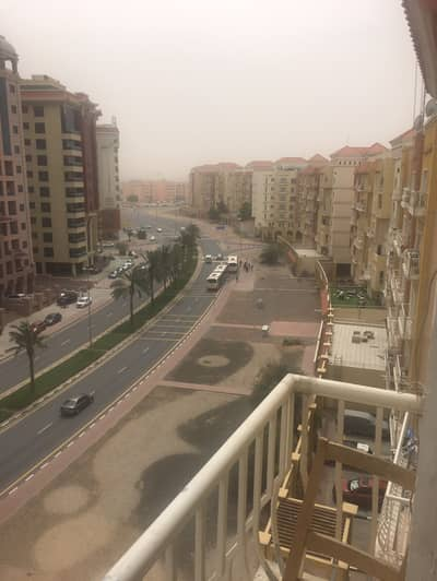 شقة 1 غرفة نوم للايجار في المدينة العالمية، دبي - شقة في بناية D-04 منطقة مركز الأعمال المدينة العالمية 1 غرف 32000 درهم - 4535840