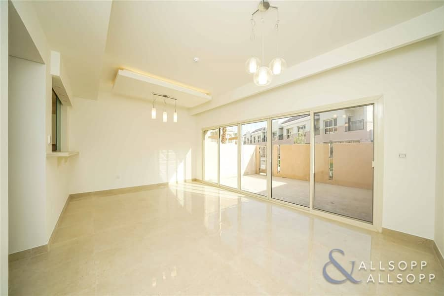 2 Plaza Backing | 2 Bed + Maids | Brand New