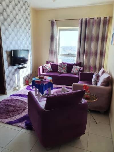 1 Bedroom Flat for Rent in Garden City, Ajman - Hall facing towards Road