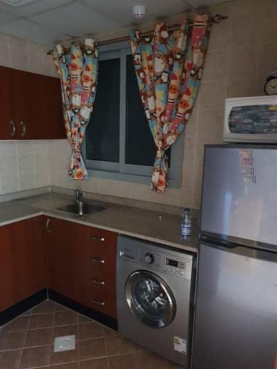 1 Bedroom Flat for Rent in Garden City, Ajman - Kitchen
