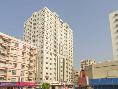 1 Bedroom Apartment for Rent in Rolla Area, Sharjah - 1 B/R HALL FLAT WITH SPLIT DUCTED A/C IN ROLLA AREA
