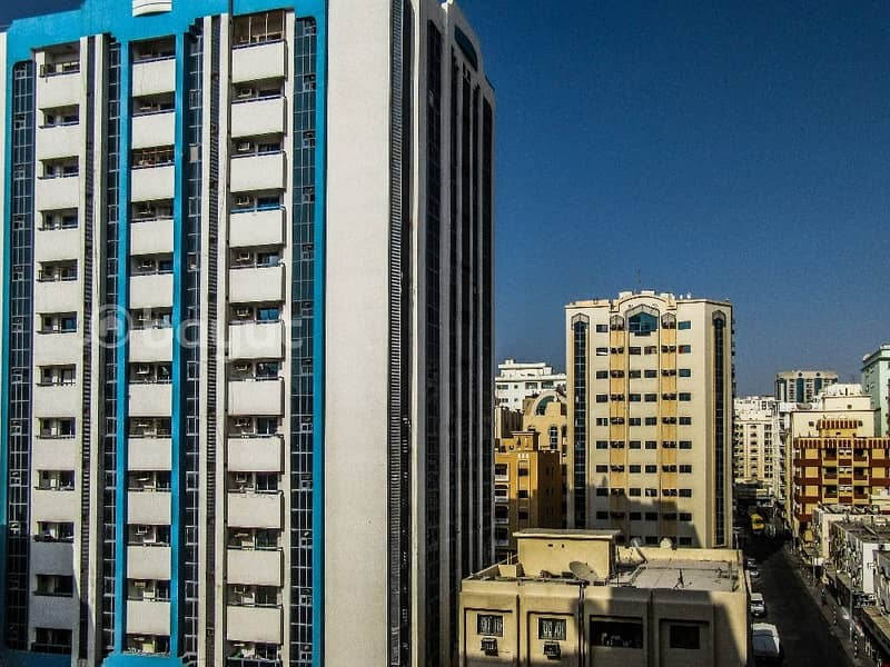 15 2 B/R HALL FLAT WITH SPLIT DUCTED A/C IN AL WAFA CENTER BUILDING