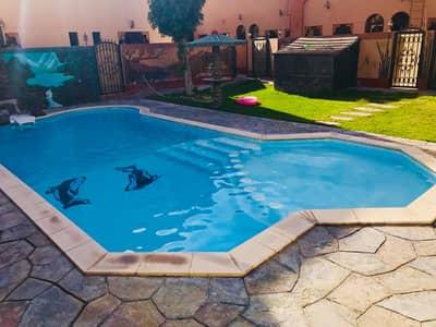 فیلا 5 غرف نوم للايجار في أم سقیم، دبي - فیلا في أم سقيم 1 أم سقیم 5 غرف 140000 درهم - 4551890