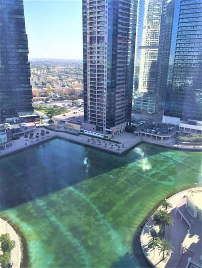 2 Bedroom Apartment for Sale in Jumeirah Lake Towers (JLT), Dubai - A READY SPACIOUS 2BR+MAIDS-ROOM WITH FULL LAKE VIEWS NEXT TO METRO St.