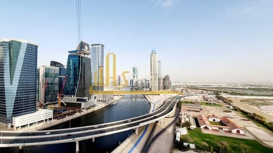 فلیٹ 1 غرفة نوم للايجار في الخليج التجاري، دبي - 1