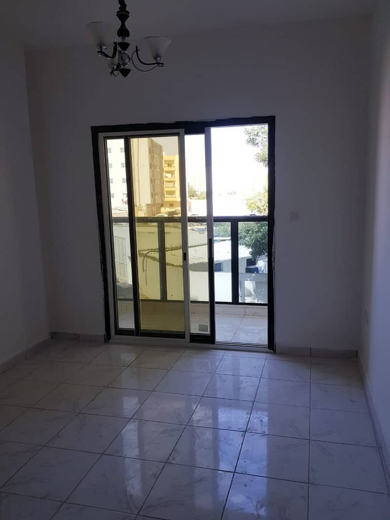 Apartment two rooms and reception for annual rent in Ajman, Rashidiya, behind Falcon Towers