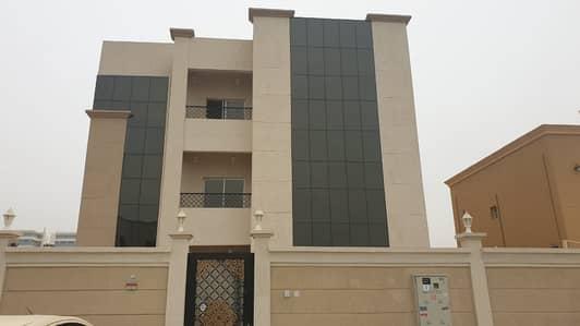 For rent villa in Al-Raqayeb area 7 master bedrooms, prime location, close to services