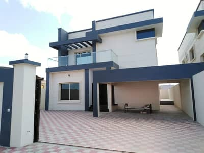 The second piece of villa from the neighbor street and modern design for sale in Ajman