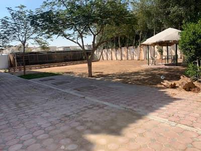 5 Bedroom Villa for Rent in Al Rawda, Ajman - GARDEN WITH BIG HOSH - 5 BEDROOM HALL MAJLIS KITCHEN - 10000 SQFT