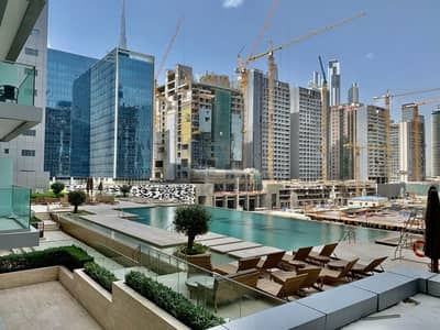 1 Bedroom Apartment for Rent in Business Bay, Dubai - Fully Furnished | Facing the Swimming Pool