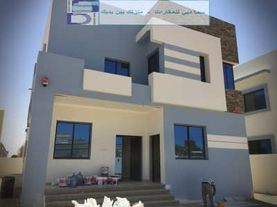 5 Bedroom Villa for Sale in Al Zahraa, Ajman - A unique and modern design villa close to the Netsu Center and all services in the finest areas of Ajman (Al Rawda) for freehold for all nationalities