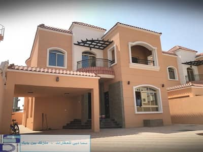 5 Bedroom Villa for Sale in Al Zahraa, Ajman - Wonderful and modern design villa close to all services in the finest areas of Ajman (Al Rawda) for freehold for all nationalities